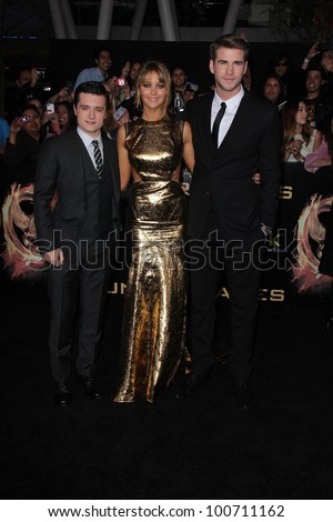 "Josh Hutcherson, Jennifer Lawrence, Liam Hemsworth at ""The Hunger Games"" Los Angeles Premiere, Nokia Theater, Los Angeles, CA 03-12-12 - stock photo"