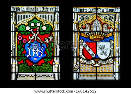 JOSSELIN, FRANCE - CIRCA APRIL 2013. Colorful windows of the church of Josselin village in Brittany, France - stock photo