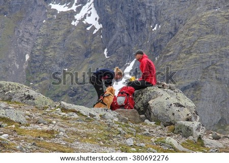 JOTUNHEIMEN, NORWAY - AUGUST 1, 2015: People rest at Besseggen trail in Jotunheimen National Park, Norway. Norway had almost 5 million foreign visitors in 2011.