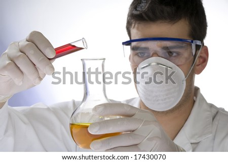joung scientist working in a laboratory - stock photo