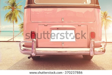 Journey of holiday - Rear of vintage classic van parked side beach in summer  - stock photo