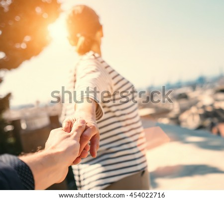 Journey together close up image couple hand taking - stock photo