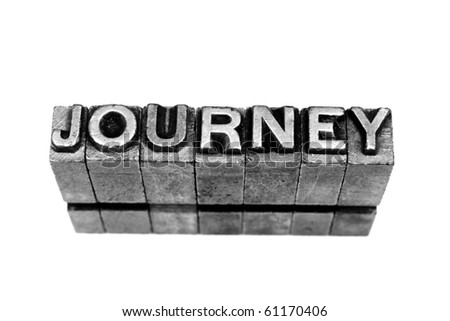 JOURNEY written in metallic letters on a white background - stock photo