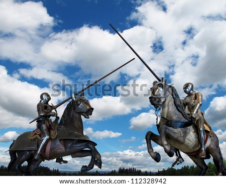 Joust between two knights on horseback - stock photo