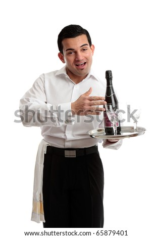 Jovial waiter, servant or bartender carrying a bottle of wine on a tray. White background. - stock photo