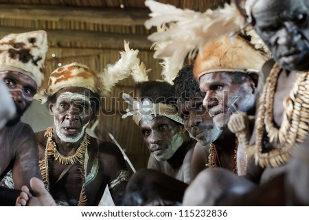 JOW VILLAGE, ASMAT DISTRICT, IRIAN JAYA , NEW GUINEA, INDONESIA - JUNE 28: Group of Asmat with a traditional painting on a face. June 28, 2012 in Jow Village, Asmat, Irian Jaya province, Indonesia - stock photo