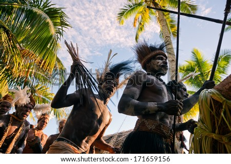 JOW VILLAGE, ASMAT, NEW GUINEA, INDONESIA -JUNE 28:The Village follows the ancestors embodied in spirit mask as they tour the village the Doroe ceremony. June28, 2012 in Jow Village, Asmat, Indonesia  - stock photo