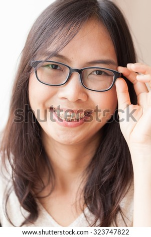 joy and smile asia woman.portrait asia woman smile and relax long black hair.wear eyeglasses.