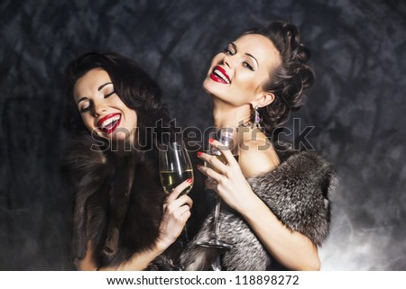 Joy. Elation. Couple of Rich Women Laughing with Crystal of Champagne. Luxury - stock photo