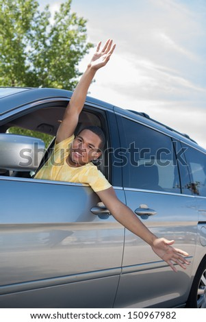 Joyful African American Male Driver Arms Out of Car Window - stock photo
