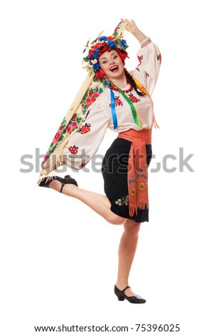 Joyful attractive woman in the Ukrainian national clothes - stock photo