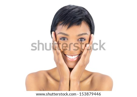 Joyful black haired woman posing holding her head on white background - stock photo