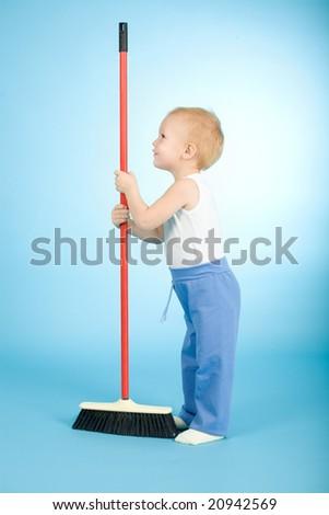 Joyful boy with cleaning swab on blue background - stock photo
