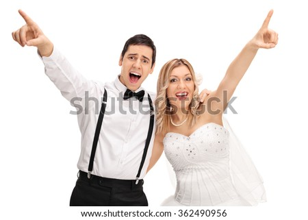 Joyful bride and groom singing together and pointing up with their hands isolated on white background - stock photo