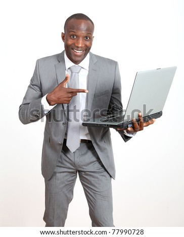 Joyful businessman with laptop computer