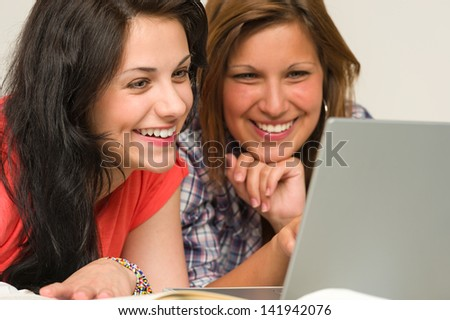 Joyful caucasian teens browsing on internet - stock photo