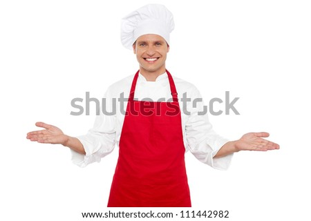 Joyful chef welcoming his guests with wide open arms. All on white background