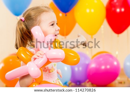 joyful child girl on birthday party