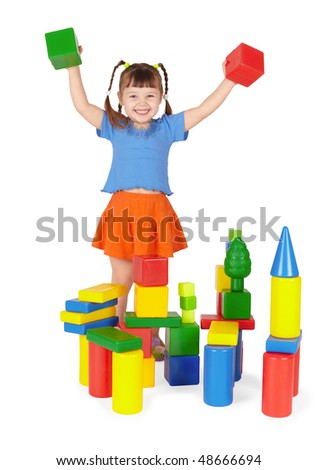 Joyful child plays in the builder isolated on a white background - stock photo