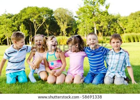 Joyful children on green grass - stock photo