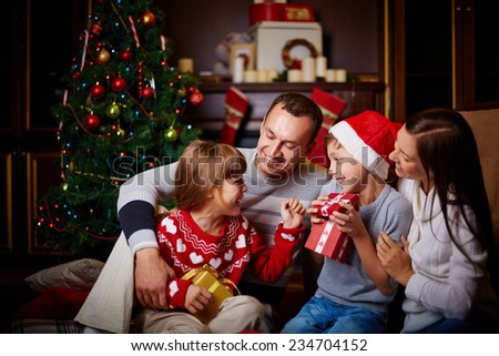 Joyful family having fun on Christmas evening at home