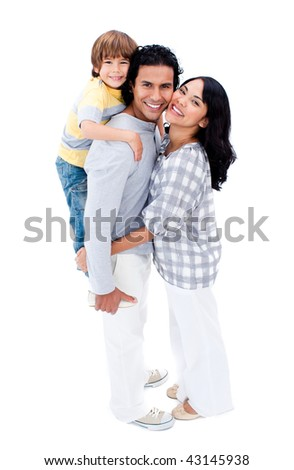 Joyful family hugging each other against a white background