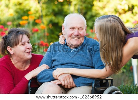 Joyful family moment - loving grandfather with his beloved. - stock photo