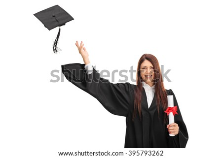 Joyful female graduate student holding a diploma and throwing her graduation hat isolated on white background - stock photo