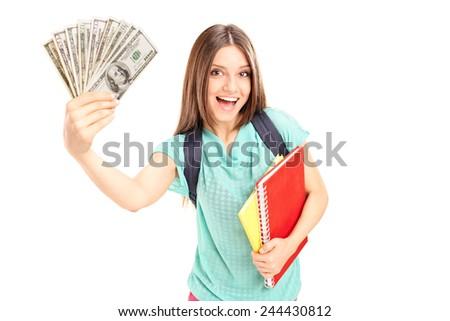 Joyful female student holding money isolated on white background - stock photo