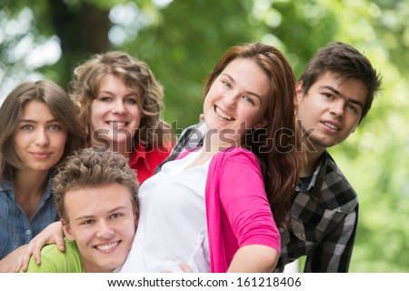 Joyful group of teenagers in nature