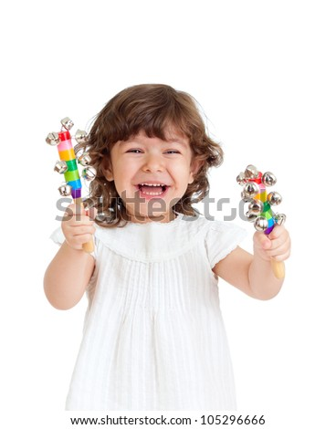 joyful kid girl playing with musical toy - stock photo