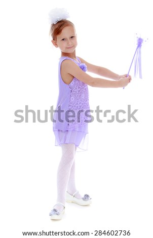 Joyful little girl holding a magic wand in his outstretched hands- isolated on white background - stock photo