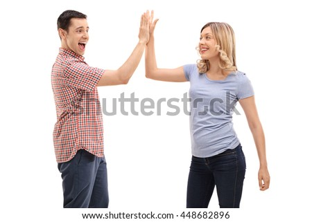 Joyful man and woman greeting each other with a high five isolated on white background