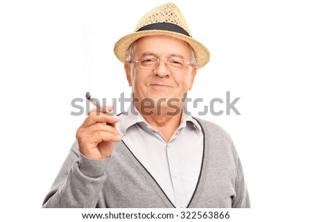 Joyful mature man holding a joint and looking at the camera isolated on white background - stock photo