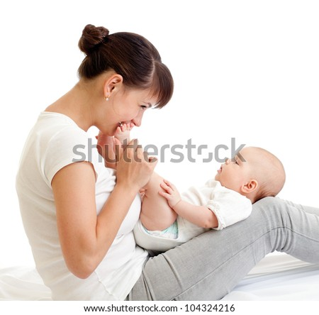 joyful mother kissing her baby infant - stock photo
