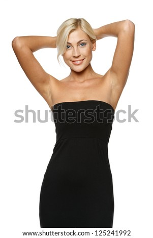 Joyful relaxed woman standing with hands over head, over white background
