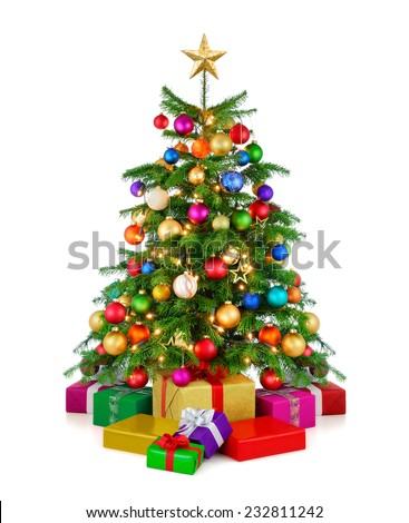 Joyful studio shot of a colorful lush Christmas tree shining in vibrant colors, with gold star on top and gift boxes arranged in front of it, isolated on pure white background - stock photo