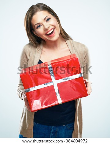 Joyful woman hold red gift box. Isolated portrait. - stock photo