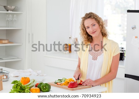Joyful woman looking at the camera at home - stock photo