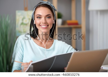 Joyful woman sitting at the table