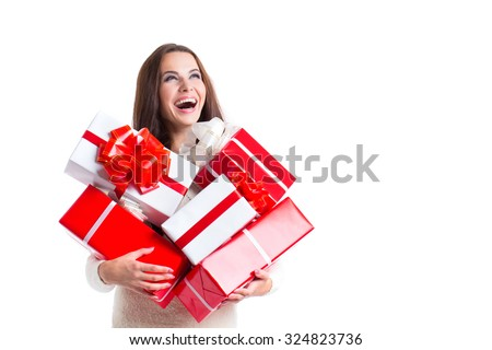 Joyful woman woman holding a lot of boxes with gifts on a white background. The concept of the holiday, shopping, christmas, new year, birthday. - stock photo