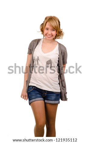 Joyful young blonde woman with a beautiful smile posing in trendy denim shorts isolated on white - stock photo