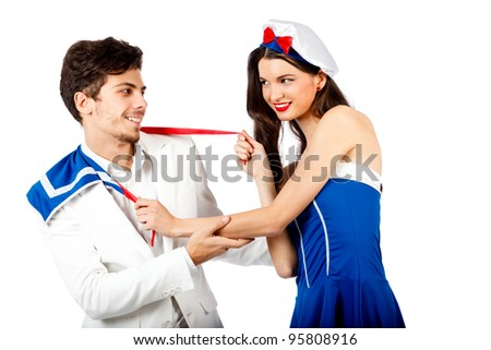 Joyful young couple enjoy roleplay in sailor uniform and elegant suit. Isolated on white background. High resolution studio image