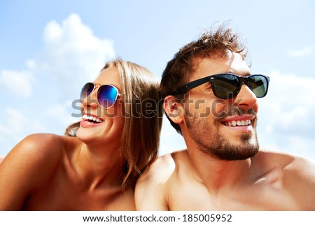 Joyful young dates having fun on sunny day - stock photo