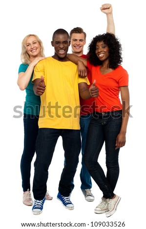 Joyful young group of friends, full length shot - stock photo