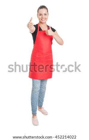 Joyful young saleswoman on supermarket showing double thumbup or like gesture isolated on white - stock photo