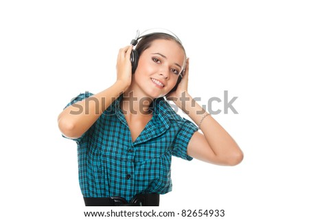 joyful young woman listening music in big headphones and looking at camera on white background - stock photo