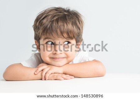 Joyfull little one with rolling eyes is happy and excited. Closeup headshot - stock photo