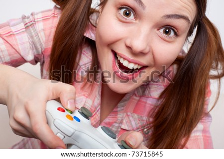 joyous young woman playing video game - stock photo