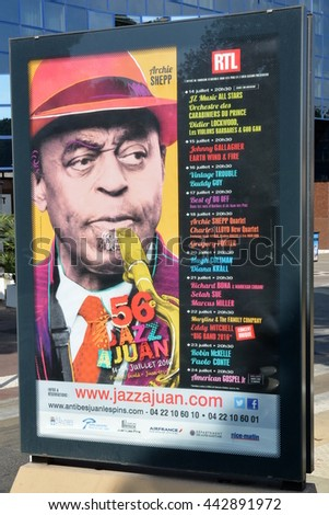 JUAN LES PINS, FRANCE-JUNE 26: The poster for the 56 th Jazz Festival shown on june 26, 2016, in Juan les Pins, France. The oldest of europeans festivals takes place  in the Gould pine forest on july. - stock photo